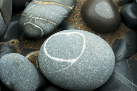 Stripped pebbles at a beach of Devon Stock Photo