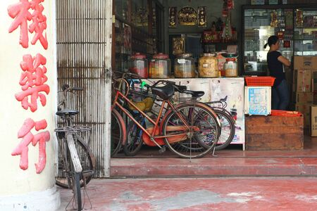 Bicycles parked in an old medicine shop in Melaka, Malaysia.