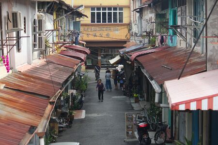 locals: Locals going about their business along old shops at Jawa street, Melaka, Malaysia. Editorial