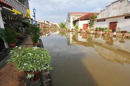 malaysia culture: Plants decorate the sidewalk along the Melaka river in Melaka city, Malaysia. Stock Photo