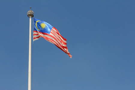sovereignty: Malaysian flag flying in wind