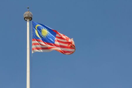 Malaysian flag flying in wind