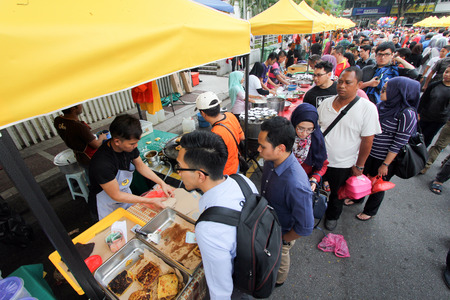 lining up: Crowd lining up to a stall selling murtabak at a ramadhan bazaar Editorial