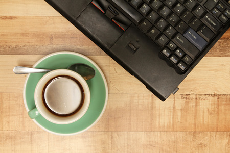 decaf: Cup of coffee with laptop