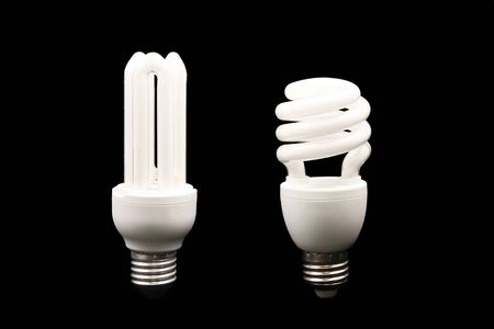 wattage: Energy efficient light bulbs on black background