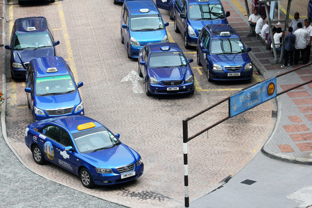kl: A row of premium taxis awaiting customers at a taxi stand at KL Sentral station.
