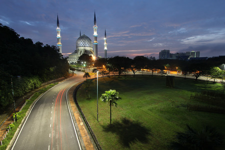The Sultan Salahuddin Abdul Aziz in Malaysia with morning sky and road with light trails