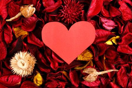 potpourri: Paper heart on red potpourri