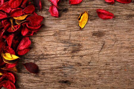 potpourri: Red potpourri flower petals on wooden background