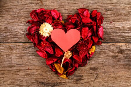 red centre: Heart in centre of red potpourri heart Stock Photo