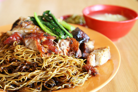 mee: Wantan noodles, a Cantonese Chinese cuisine served dry with soy sauce and roast pork.