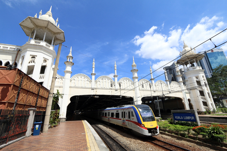 kl: Train leaving the old KL station in Kuala Lumpur city.