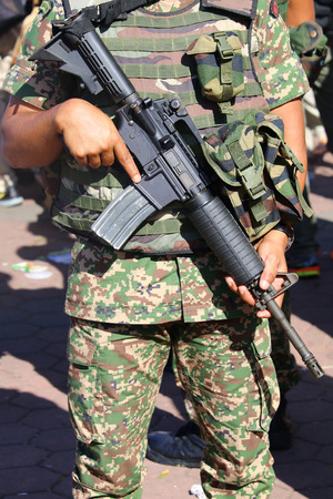 counter terrorism: Military personnel holding assault rifle