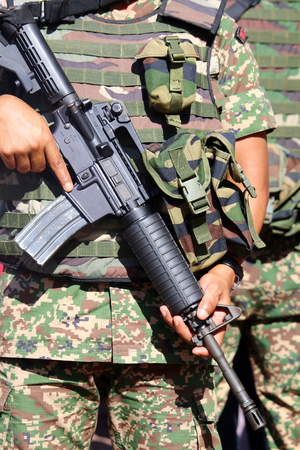 insurgency: Military personnel holding assault rifle