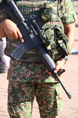 commando: Military personnel holding assault rifle