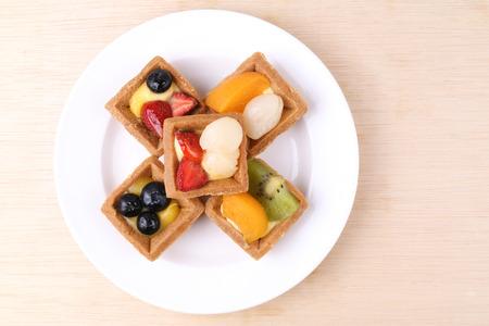 tarts: Assorted fruit tarts on a plate Stock Photo