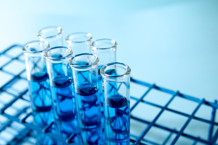 laboratory labware: Test tubes filled with blue chemical Stock Photo