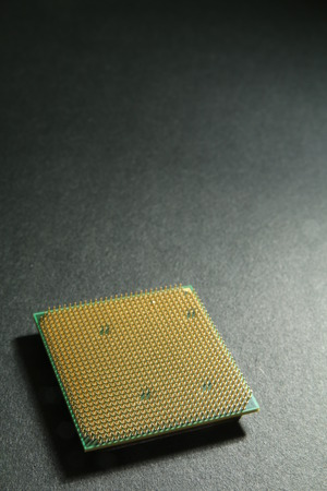 microprocessor: Microprocessor chip on black surface Stock Photo