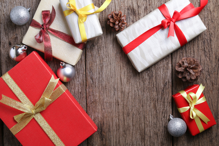 Presents on wooden surface with christmas decoration