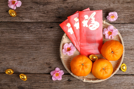 Basket of mandarin oranges with Chinese New Year decorations Stock Photo