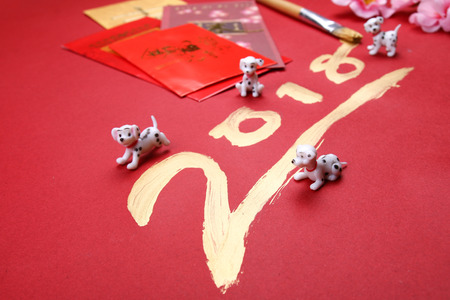 Miniature dogs with 2018 written in gold for 2018 chinese new year Stock Photo