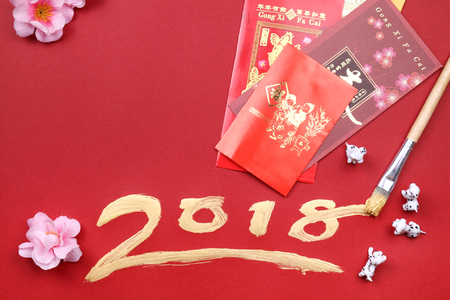 Miniature dogs with 2018 written in gold for chinese new year