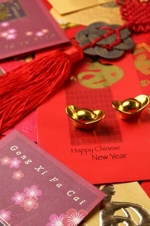Gold ingots with chinese new year angpow envelopes