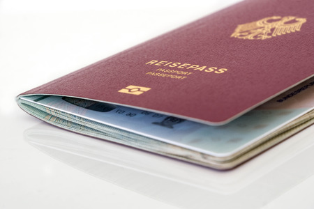 German passport on a table Zdjęcie Seryjne