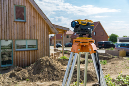 Construction site of a building with theodolite measuring device