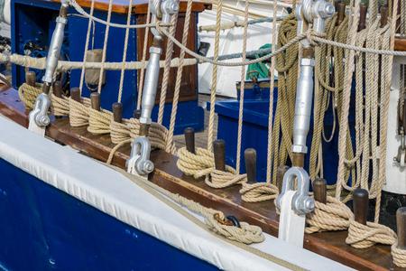 Ropes at a railing of a sailing boat