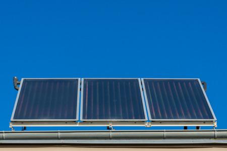 solar thermal power plant on the roof - blue sky Zdjęcie Seryjne