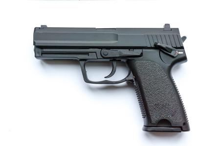 black handgun or pistol on white background Zdjęcie Seryjne