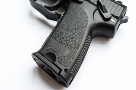 handgrip of a pistol on white background