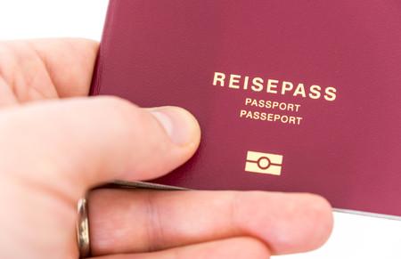 hand holding german passport - German passport with the german word