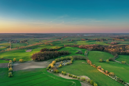aerial view of agricultural fields during sunset - colorful landscape