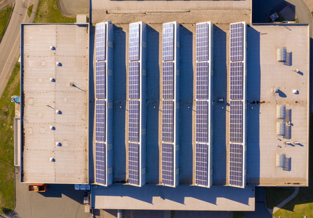 Top view of a roof of a factory building with solar panel or photovoltaic plant