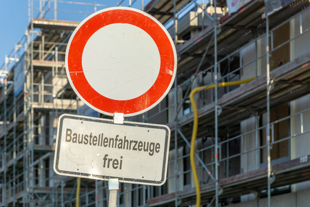 Construction site of a building with traffic sign - showing the german words - Construction vehicle free means free for construction site vehicle Zdjęcie Seryjne