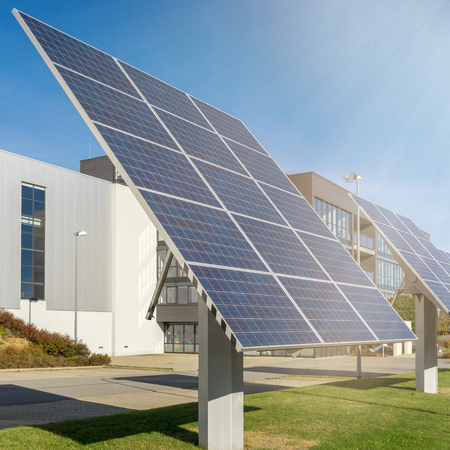 solar power plant in front of a factory building