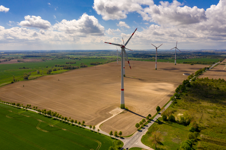 agricultural field with windmills or turbines