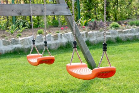 Empty swings in the garden - playground for children