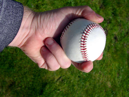 Hand holding a baseball Stok Fotoğraf