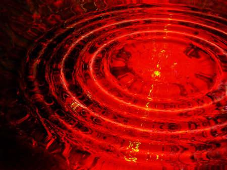 Rood laserlicht door het water ripples Stockfoto