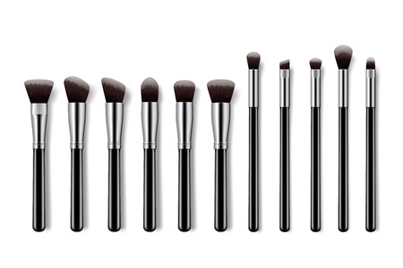 Set of makeup brushes, professional makeup kit concealer powder eyebrush with black handles on colorful pastel background.