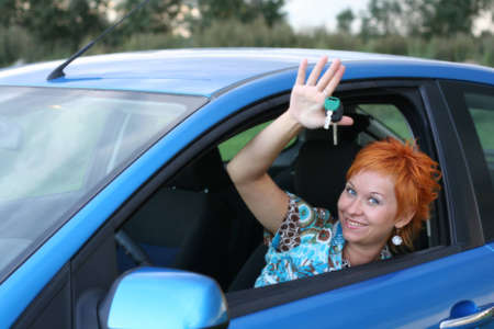 Young woman in a car with key Stock Photo - 1524902