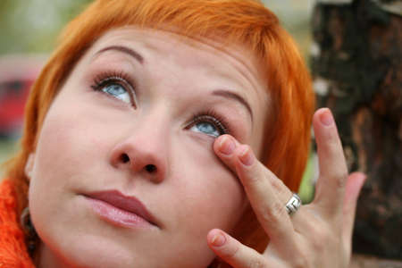red head woman: young crying red head woman Stock Photo