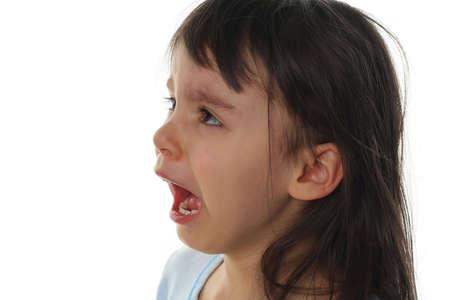uncomfortable: Extremely sad little girl crying isolated on white background