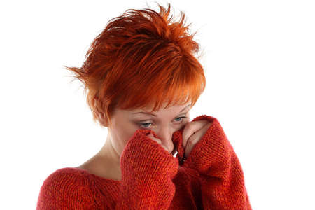 sad red haired woman isolated on white background photo