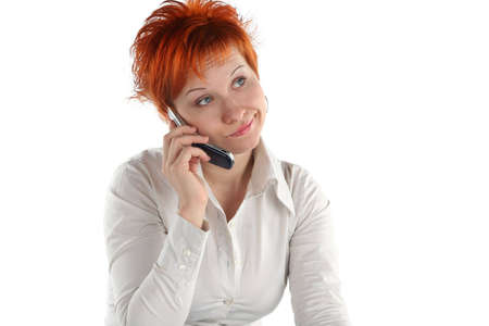 waiting phone call: red haired woman talking by mobile phone unhappy