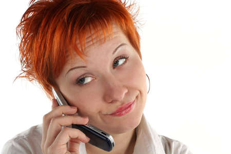 red haired woman talking by mobile phone unhappy photo