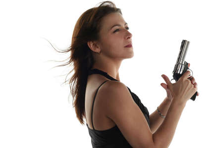 young woman with revolver isolated on white background photo